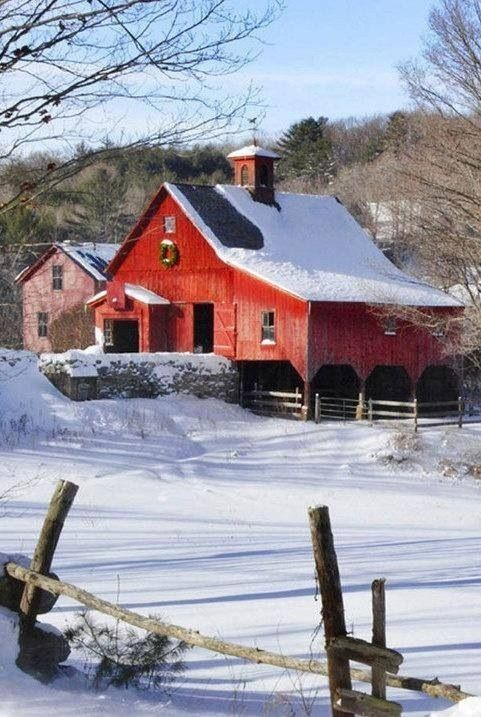 red barn in winter w/wreath & pink house