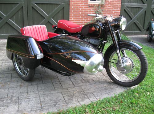 Tomboy Tailors is looking for a rig that looks just like this. Call us if you know of one for sale.  This is a Pannonia motorcycle with a Duna sidecar!  Beautiful!