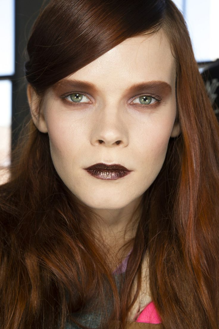 Metallic bronze shadow was worn from lids to brows, whilst lips were coated in either pale pink or brown glitter at Rodarte FW 2014