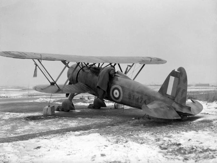 Fiat CR.42 Falco (RAF serial BT474) of the RAF Air Fighting Development Unit, parked at RAF Duxford. The aircraft forced landed on the beach...