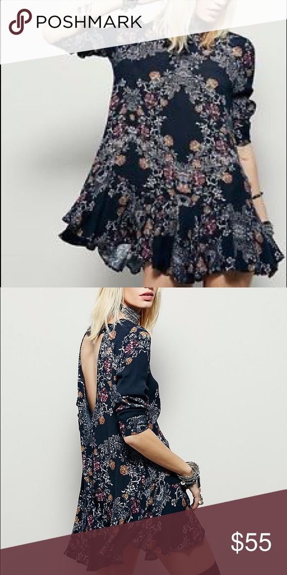 Free People Smooth Talker Free People Smooth Talker.  Floral print tunic in black. Long sleeves. Scoop neck. Back cutout Free People Dresses Mini