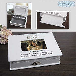 """Product # SM98801 - This fabulous treasure box holds all the photos, keepsakes and mementoes from your child's First Communion! Hinged, magnetic lid holds a 4""""x 6"""" picture, with an album hidden inside, to hold 14- 4""""x6"""", and 4 - 6""""x8"""" photos. Felt-lined interior is perfect for storing letters, cards, order of service and keepsakes. Special compartment inside holds a certificate for safe-keeping. Beautiful painted wood box. Personalization: 2 lines, up to 50 characters per line. $59.98"""