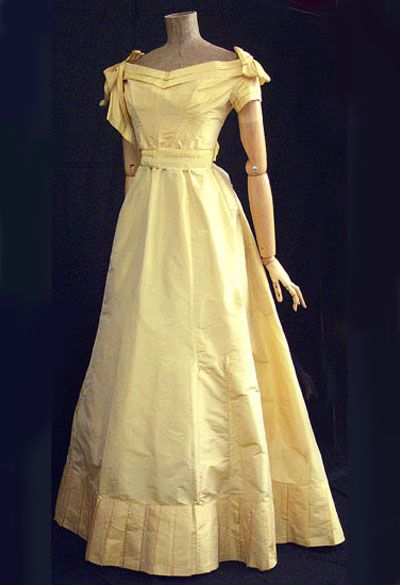 Silk taffeta ballgown, c.1870 This lovely ball gown is fashioned from unfaded gold taffeta.