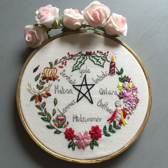 This pagan/Wiccan year wheel shows all of the pagan sabots with pretty flowers and seasonal stitches. The embroidery sits in a 5 wooden hoop which has