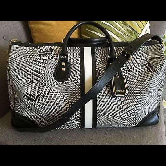 ISO L.A.M.B. Not selling. I am looking for L.A.M.B. Items such as these in excellent, smoke free condition. Please tag me if you have or see these patterns/styles for sale anywhere. Thank you! L.A.M.B. Bags