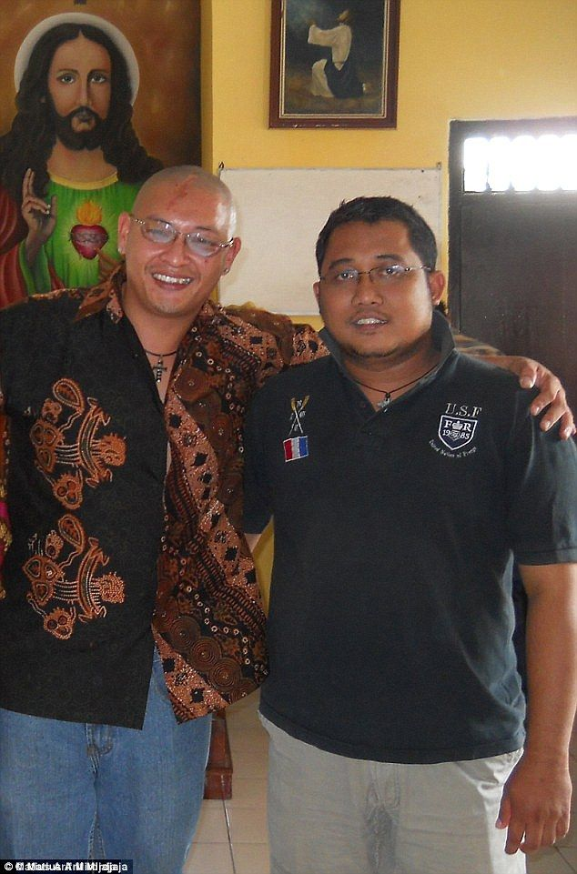 Matius Arif Mirdjaja (right), a former inmate of Kerobokan prison, has told of how he was baptised by Bali Nine drug smuggler Andrew Chan (left) and is struggling to cope with the news of their duo's impending execution