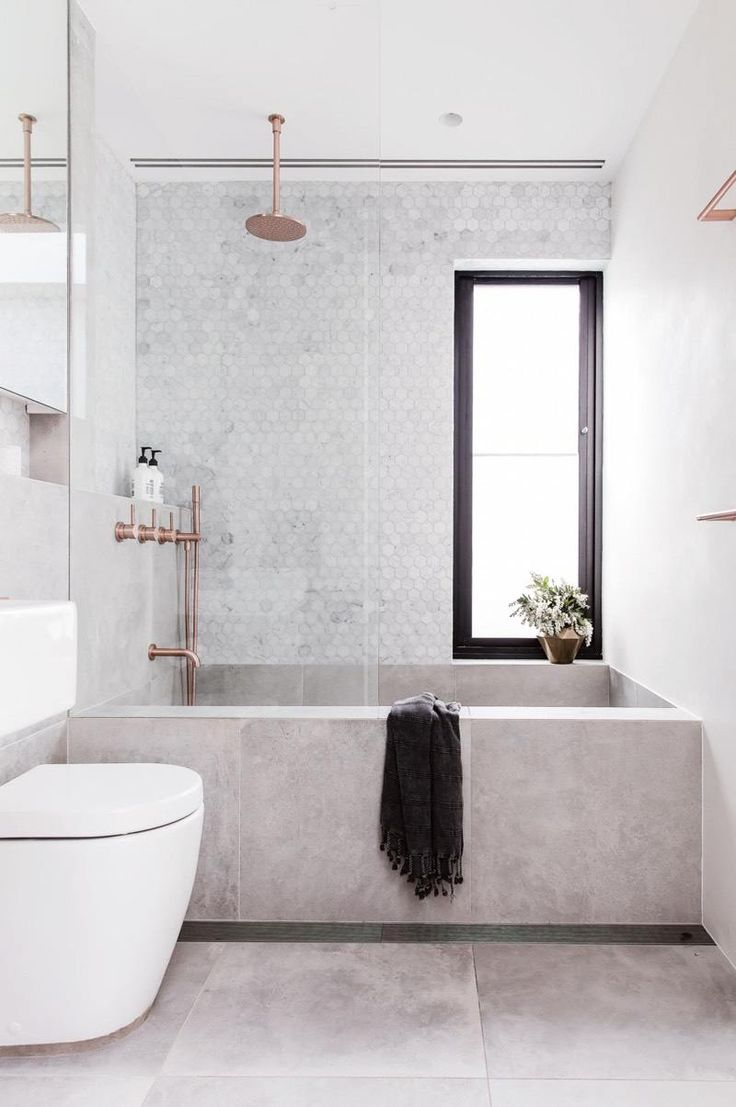 Concrete Bathtub and Tile Backsplash