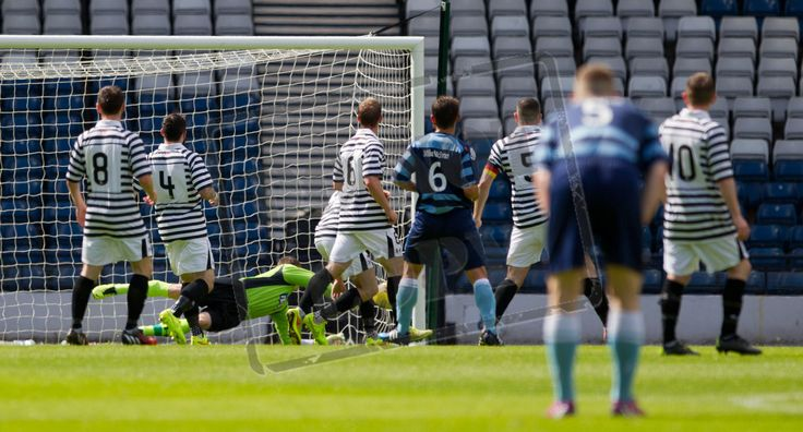 Queen's keeper Wullie Muir can't get to the shot by Forfar's Derek Young.  1-0 to Forfar.