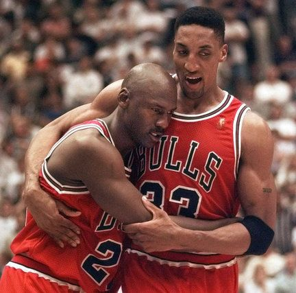 The Chicago Bulls' Michael Jordan collapses in the arms of teammate Scottie Pippin, at the end of Game 5 of the NBA Finals with the Utah Jazz in Salt Lake City, on June 11, 1997.