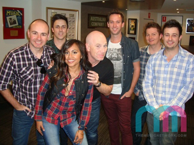 Jessica Mauboy fits in nicely with her plaid-shirted friends of SCA's regional content team.