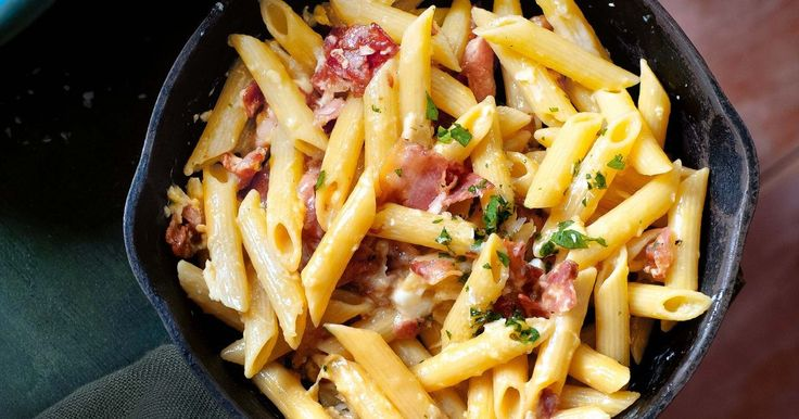 Salty pancetta and creamy egg pair in our take on one of Lazio's most famous pastas.