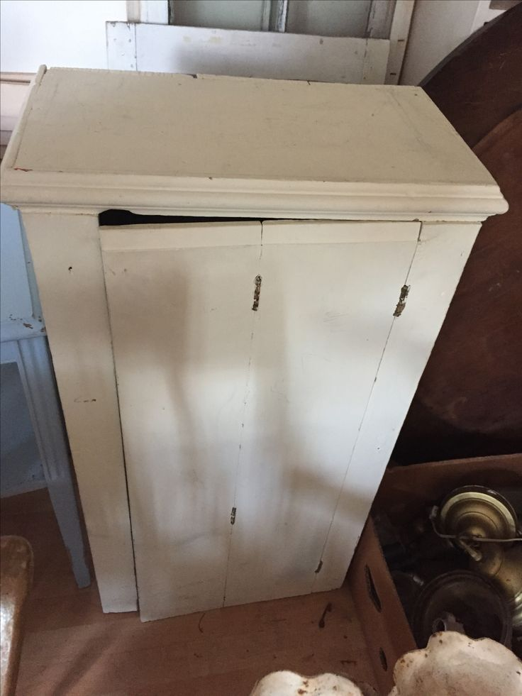 Cream painted cupboard with interior shelves $75