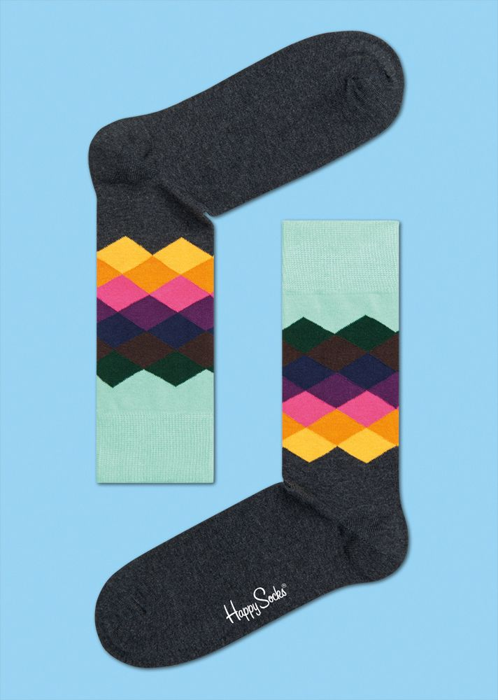 FADED DIAMOND: Graphic · Timeless · Detailed. Give feet a makeover with colorful faded diamond socks. These black graphic socks feature rhombuses in yellow, orange, purple, brown and turquoise to create an energetic yet classic motif. Fashioned from the finest combed cotton ensures high quality and a comfortable pair of socks that will make men and women happy. COMPOSITION 80% Combed Cotton, 17% Polyamide, 3% Elastane. www.HappySocks.com