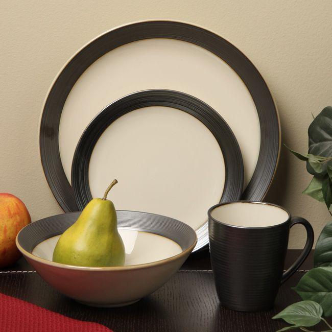 <li>Casual dinnerware makes any table more appealing</li><li>Dinnerware set includes four each: dinner plates, salad plates, bowls and mugs</li><li>Sango dishes feature a cream-color eating surface</li>