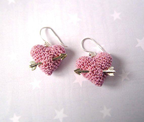 Handmade crochet heart earrings with silver arrow.
