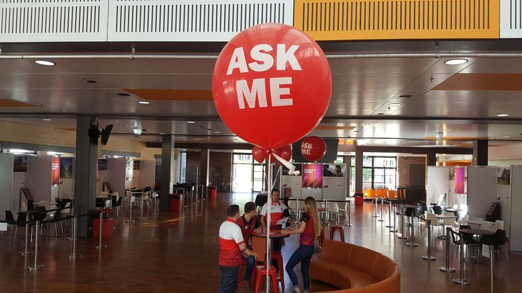Silk screen printing onto this 3ft red balloon.www.balloons.com.au