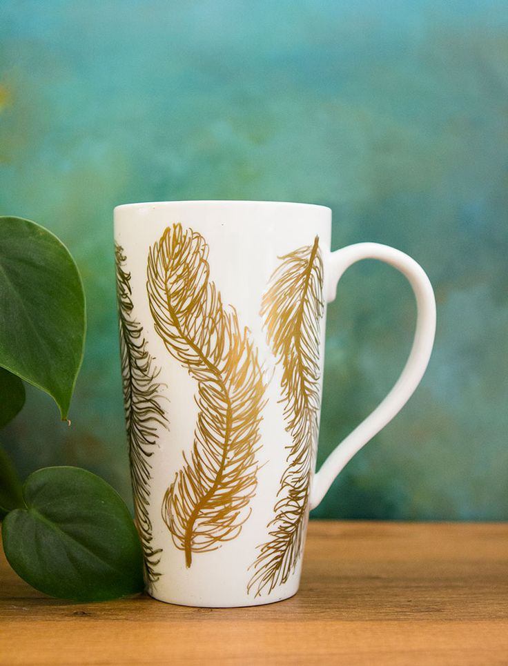 DIY Modern Mug Makeover - love this simple and super creative idea for turning plain white mugs into artsy gifts! This tutorial shows how to decorate ceramic coffee mugs with a gold Sharpie then bake them in the oven to set the design. So fun -- from Sarah Johnson!