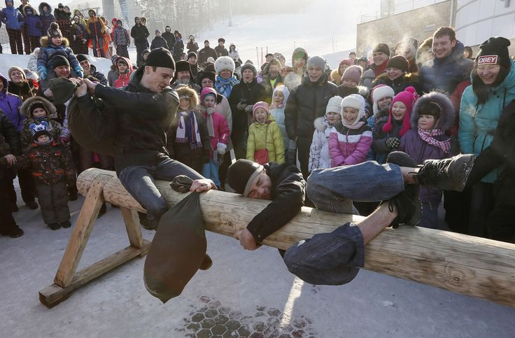 Men take part in a pillow fight contest during Maslenitsa celebrations at the Bobrovy Log ski resort in the suburbs of Krasnoyarsk on February 22, 2015.