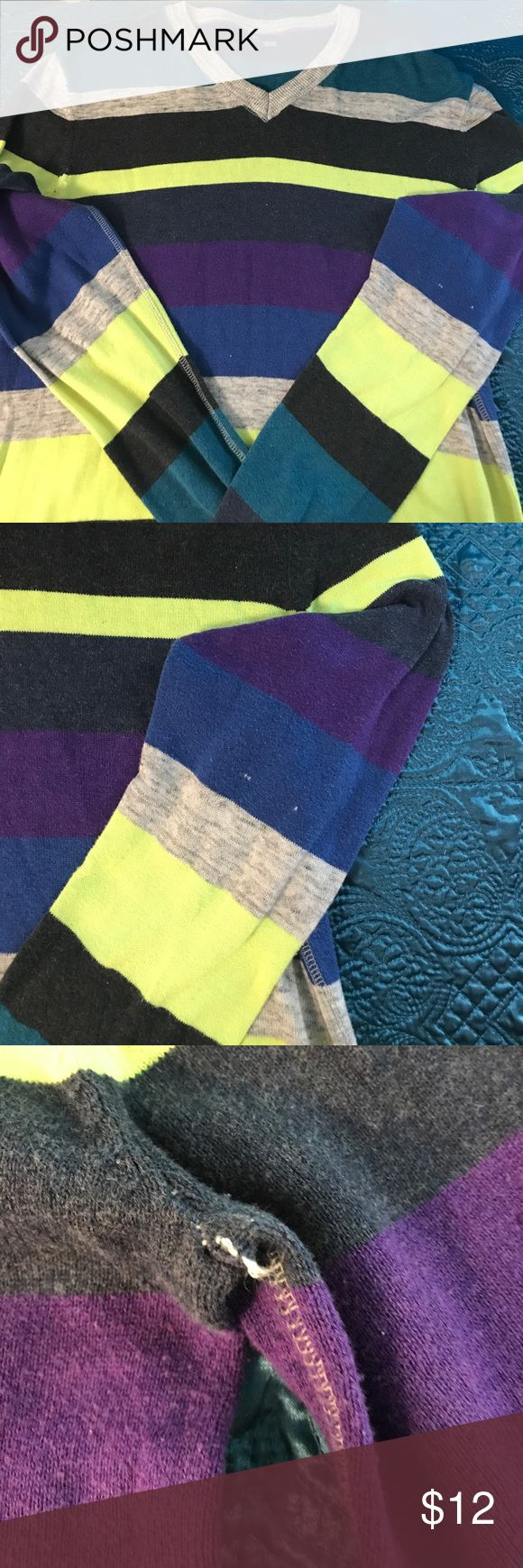 Used multi-colored men's sweater by H & M Used men's multi-colored V neck sweater size medium. There is a little snag on left sleeve as pictured and under the arm, which is pictured as well. The sweater is grey, teal, purple, lime green, and navy blue. H&M Sweaters V-Necks