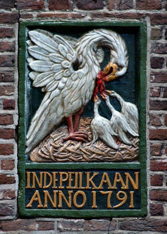 VVAG .. Negen gevelstenen opgeknapt door Wil Abels, Oudezijds Kolk Amsterdam