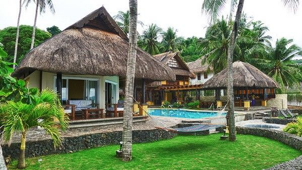 You'll enjoy the tropical island feel the moment you set foot onto the property, starting with beautifully landscaped grounds that guests often compliment. # http://thebeachfrontclub.com/beach-hotel/asia/philippines/mabini/bagalangit/vista-aplaya-resort/