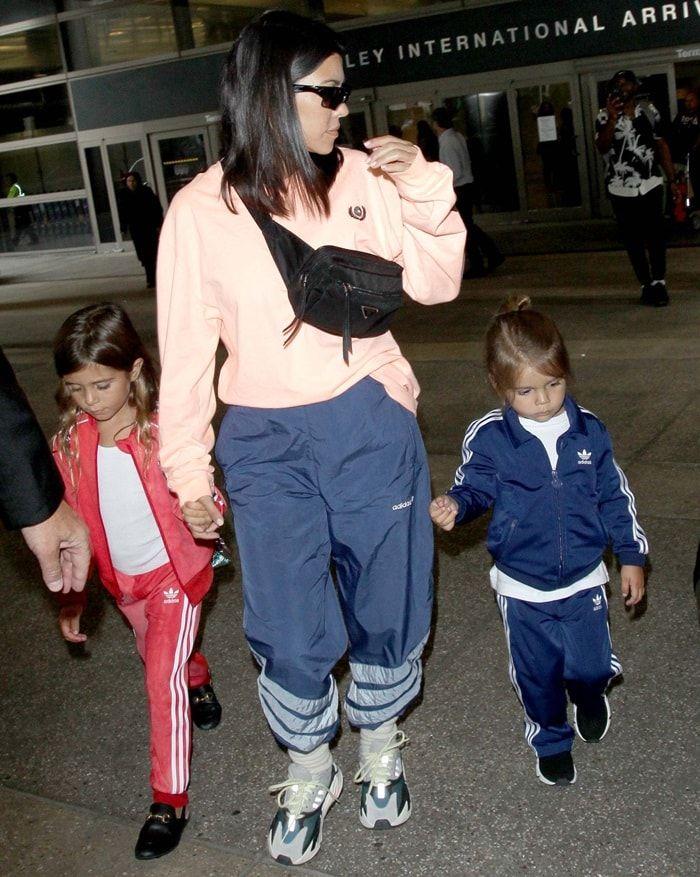 official photos 5d657 d3f52 Kourtney Kardashian Rocks Adidas Yeezy 700 Wave Runner Sneakers