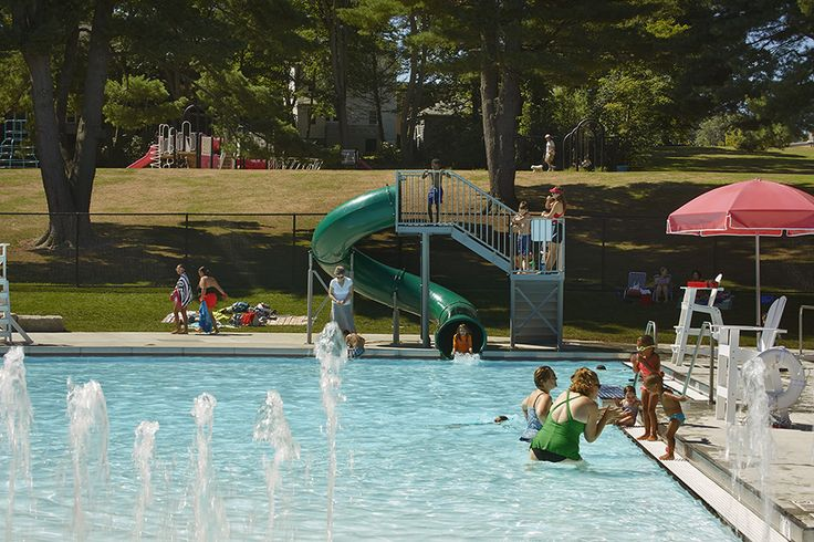 This Family Pool, Part Of A Larger Public Pool Complex, Includes A Kiddie  Slide