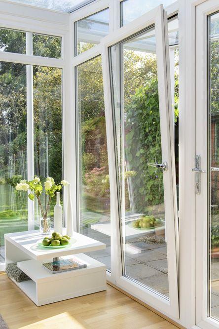 White uPVC Tilt & Turn window in tilt position within a conservatory