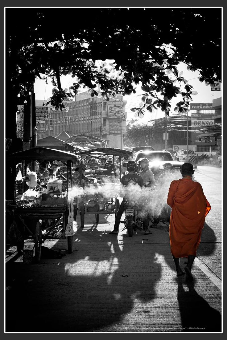 """Beautiful contrast of the black and white  and the vivid color of the Monk""""s robes"""