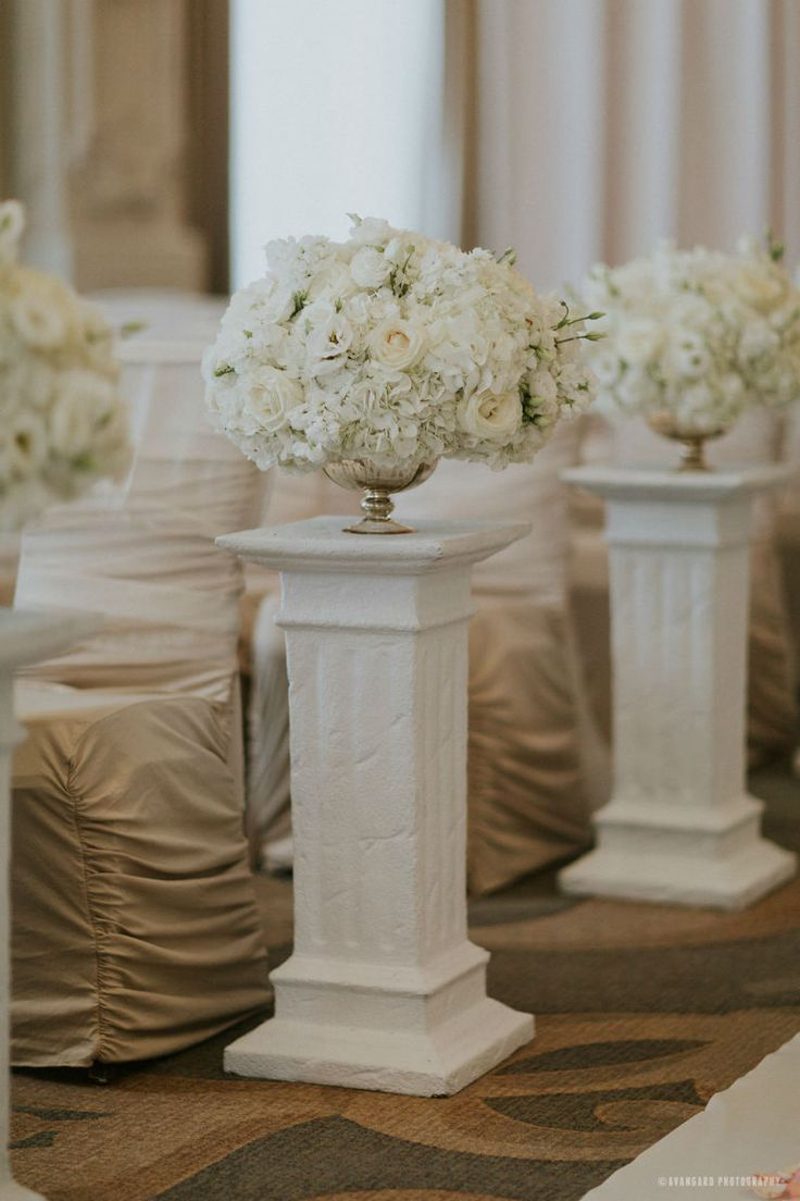 White wedding flowers on columns to line the aisle for your ceremony! CLASSIC WHITE WEDDING AT KING EDWARD HOTEL www.elegantwedding.ca