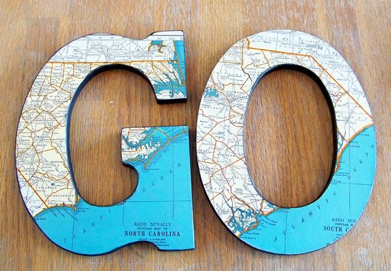 Thinking I could DIY this with atlases I bought from the used store and wooden letters from the dollar store. Hmmmm....