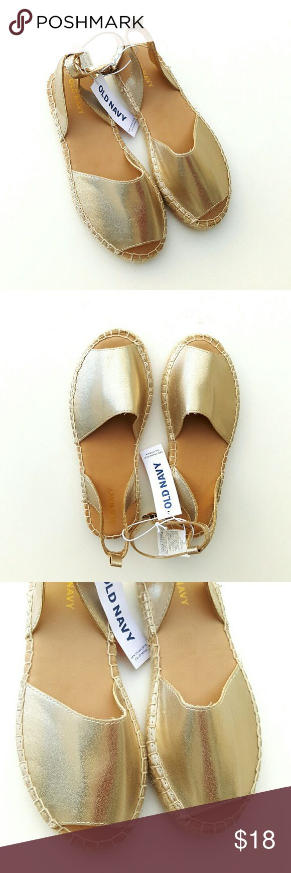 Old Navy Girls Gold Espadrilles Shoes feature:  Flat sandal  Ankle Strap  Smooth footbed w/ logo print  Rubber sole with traction Old Navy Shoes