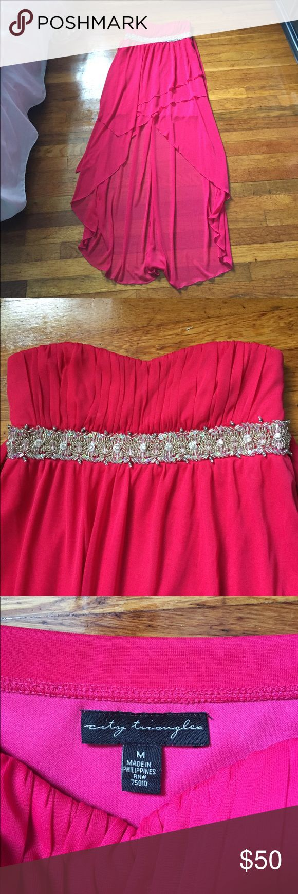 Prom/Formal dress Only worn once or twice. Great condition and has been dry cleaned. High/low style. Strapless and ties around in the back. Ask questions! Price is negotiable, so make an offer! Sherri Hill Dresses Prom
