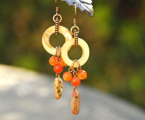 """Perfect color for the season...these are inspired by the Goji berries growing in my yard! Made with green shell donuts, orange jade and stone """"sticks"""". Size: Length: 3.5 inches from top of earwire"""