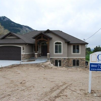 CF Olsen Homes, exterior, stucco and rock, wood arch entrance, brown garage door
