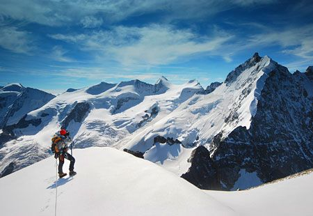Mountain climber on Piz Bernina, near St. Moritz, Switzerland (© ASankowski/F1 Online/Photolibrary)