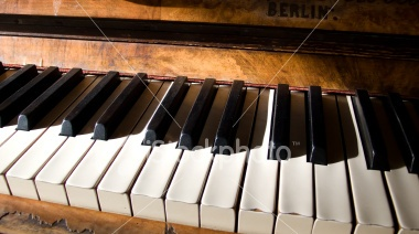 Late afternoon view of a rustic looking piano keyboard