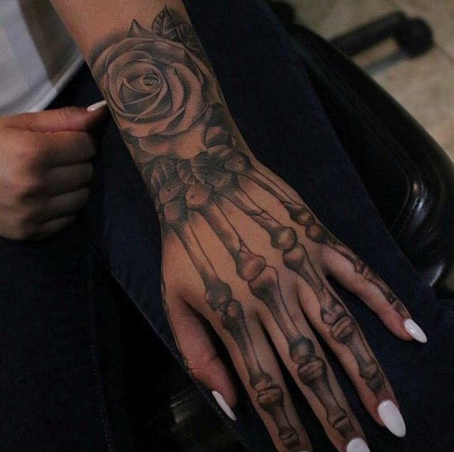 Rose Skeleton Hand tattoo Ideas | I like this