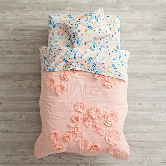 Just the sheets, with a more neutral/modern blanket.  Floral Rush Toddler Bedding  | The Land of Nod