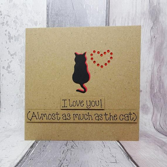 This handmade funny cat card would be perfect for Valentines Day or an anniversary. This funny Valentines Day card features a cat silhouette and gems in the shape of a heart.  The card has the silhouette of a cat sitting happily with their tail hanging down. The shadow of the cat