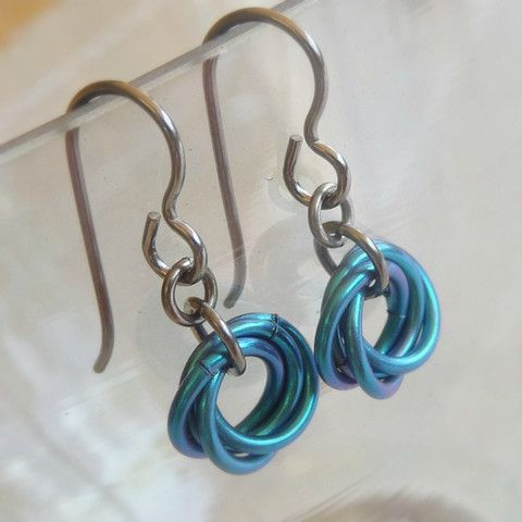 Nickel free earrings teal blue love knots.  Hypoallergenic pure niobium comes with a 100% No Allergy Guarantee. Handmade by Nonita - nickel free jewelry