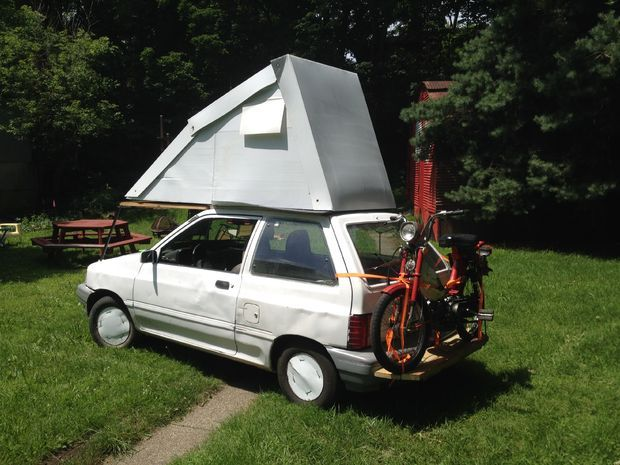 A Ford Festiva Flip Top Camper - I'll probably never do this, but its such a cool thing, I had to post