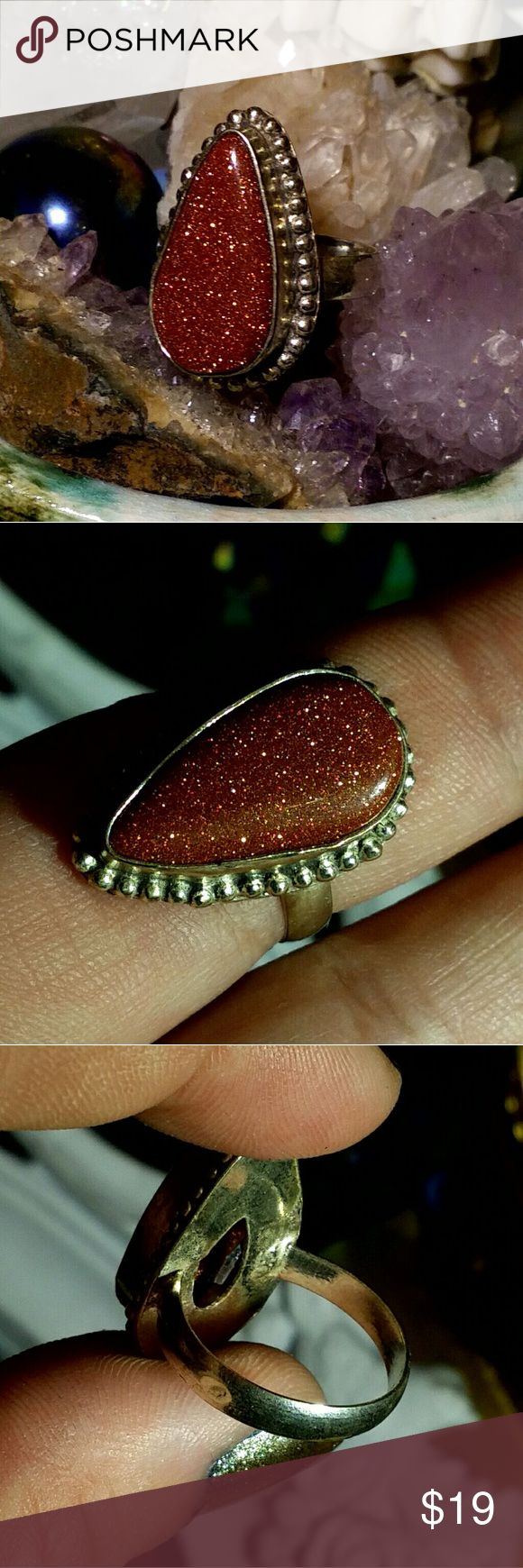 Size 6.5 Goldstone 925 Stamped Ring One of a kind ring featuring a polished goldstone cabochon on a 925 stamped sterling silver plated brass frame. Ring is handmade.  Only one available! Size 6.5  Setting is 0.8 inches long.  Goldstone will boost the glow of one's life force, strengthening the inner self, and chi. With the properties of Copper as well, it is extremely helpful in increasing the strength of circulatory system, which in turn bolsters the bones, easing arthritic pain and…