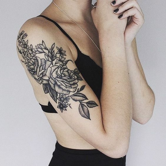 Roses tattoo on upper arm