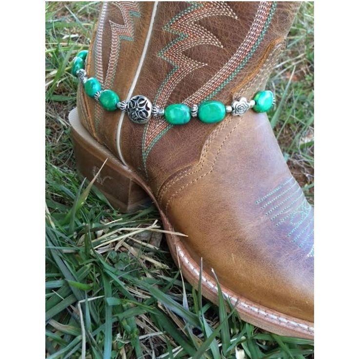 Dress up your boot with a handmade beaded boot bracelet including blue/green stones and small silver flowers! -Incorporated with a silver bead! -14.5 Inches -Alligator Clasp