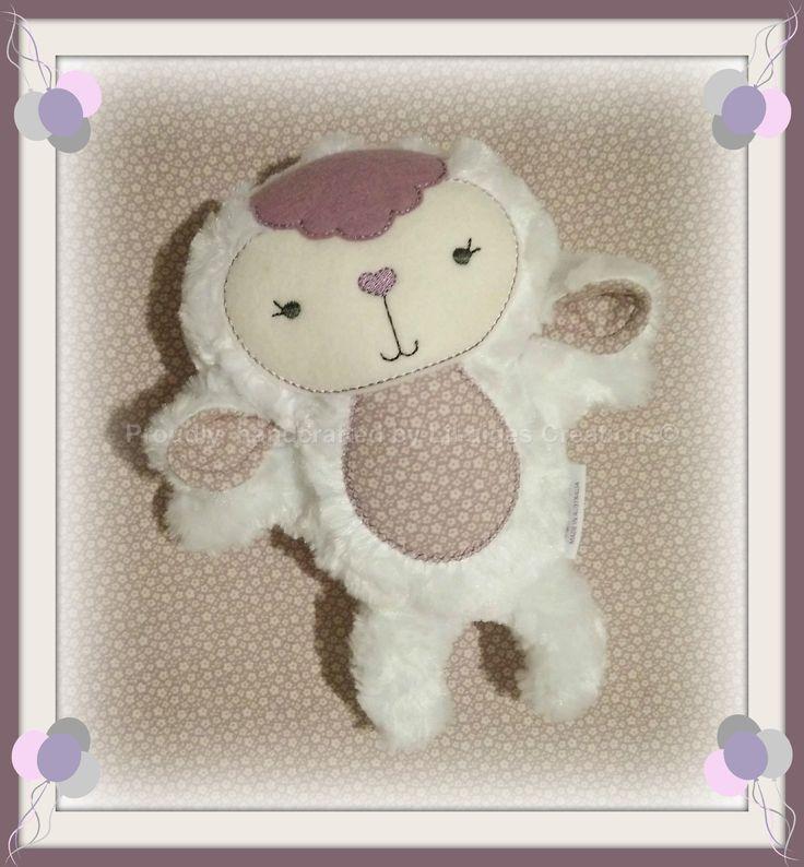 Gorgeous lil lamb.  Created in minky rose, 100% merino wool felt and Tilda fabric.  Design by:  www.dollsanddaydreams.com