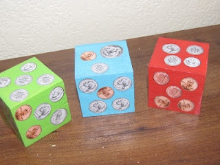 Money Dice -- modge podge money cut-outs on each side and have students roll, then add up the amount