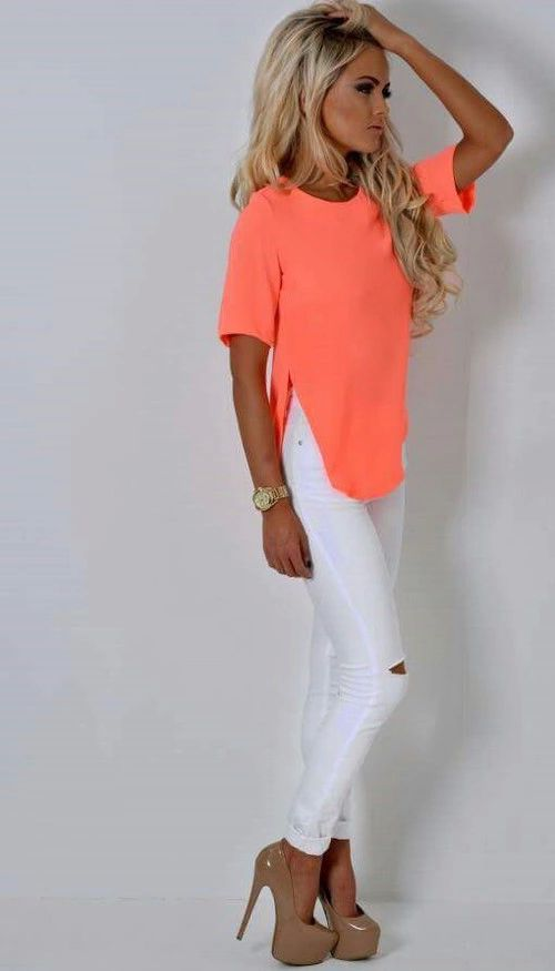 neon top & white ripped skinnies look great  love the color  Like the pants and the bright shirt.