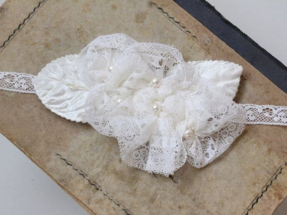 Bridal lace sash with handmade floral applique. I have created these white flowers from a vintage lace, found in a tiny antique shop in Belgium. Flower centers are adorned with Swarovski 6mm pearls. There are also vintage velvet leaves, plus flower stamen. The floral applique sits on a vintage lace too, so you tie it in the back. The bride wear blush pink version of the headpiece.  Can be worn as a headband too. Or I could attach it to a alligator clip.  Lovely accessory and also Something…