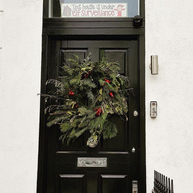 The best of all gifts around any Christmas tree: the presence of a happy family all wrapped up in each other. ~Burton Hillis.  .  .  .  #london #prettycitylondon #visitlondon #londonforall #itssolondon #londonforyou #moodygrams #justgoshoot#ig_london #artofvisuals #watchthisinstagood #uk#londonhouse #londondoors #christmas #christmaswreath#worldtravelpics #season #winterinlondon #uk#englishdoors #doorstep #doors #quotes #signs #visitlondon#thedoorsofldn#prettycitylondon #prettydoortraits